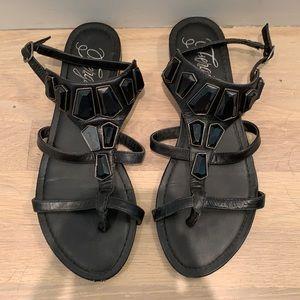 Black low key gladiator like sandals